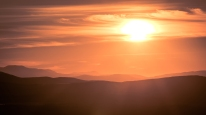 Midnight sun over the mountain range as seen from the hill Luossavaara.