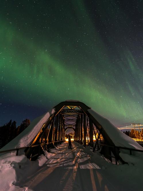 The Kalixfors bridge under the northern lights.