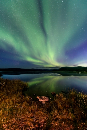 Autumn night by the water in Pirttivuopio. The first sighting of the northern lights of the season.