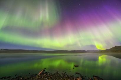 Veils of light over a foggy lake in Pirttivuopio, Kiruna.