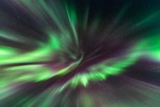 Massive corona in purple and green.