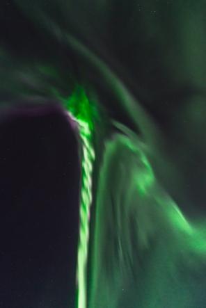 This auroral corona formed a strange and unusual shape. Like a massive cosmic corkscrew or braid.